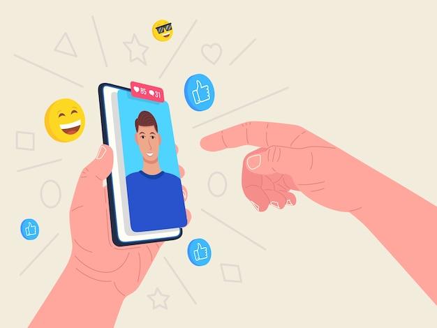 Mão segurando o telefone com avatar masculino. conceito de mídia social. .
