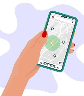 Mão segurando o telefone com mapa e marcador