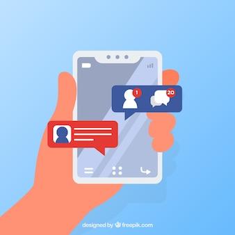 Mão segurando o telefone com notificações do facebook