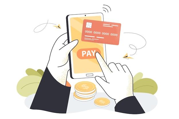 Mão segurando o telefone e fazendo compras com cartão de crédito