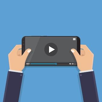 Mão segurando o telefone inteligente, assistindo vídeo, ilustração em vetor design plano