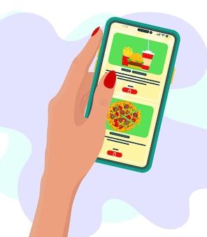 Mão segurando o telefone inteligente com o botão de compra na tela