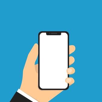 Mão segurando o telefone. smartphone com tela em branco.