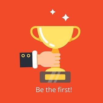 Mão segurando o troféu. conquista da taça de ouro do conceito de vitória empresarial para o fundo do vencedor