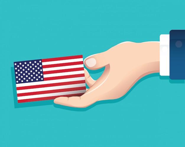 Mão segurando o vetor de cartão de bandeira eua