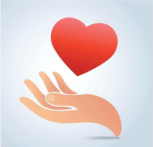 Mão segurando o vetor de coração