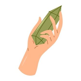 Mão segurando pedra verde de quartzo cristal. elemento de design esotérico e místico. ilustração em vetor mão desenhada.