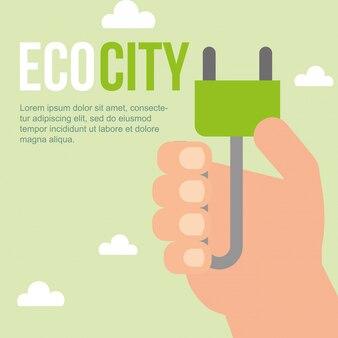 Mão segurando plug eco cidade sustentável