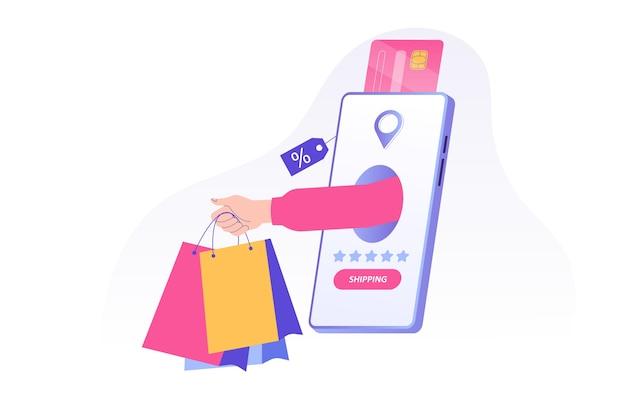 Mão segurando sacolas de compras e entregando da enorme tela do smartphone