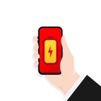 Mão segurando smartphone com tela de carga da bateria