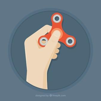 Mão segurando um girador vermelho