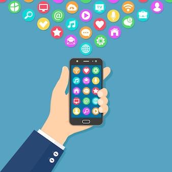 Mão segurando um smartphone com ícones de aplicativos coloridos na tela