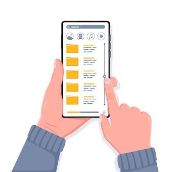 Mão segurando um telefone celular moderno com pesquisa de pastas e dados
