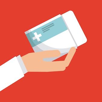 Mão segurando uma caixa de pílulas