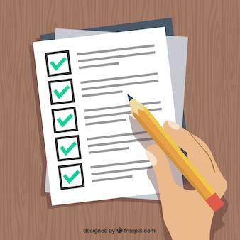 Mão segurando uma caneta e preencher um formulário