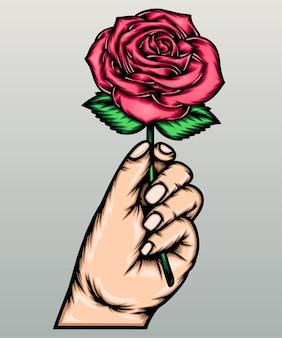 Mão segurando uma rosa.
