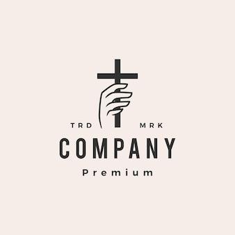 Mão segure cristo cruz moderno logotipo vintage