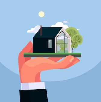 Mão segure o layout da casa conceito imobiliário ilustração plana dos desenhos animados