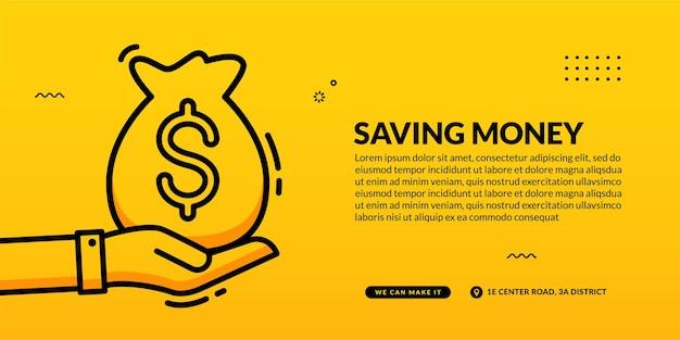 Mão segure o saco de dinheiro em fundo amarelo