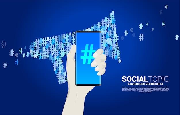 Mão segure o telefone móvel com grande megafone. conceito de tópico de mídia social e notícias.