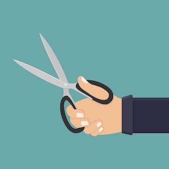 Mão segure uma ilustração plana de tesoura