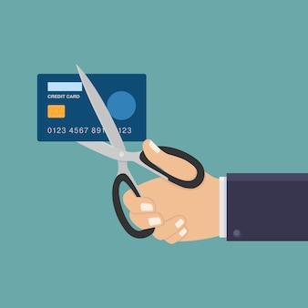 Mão segure uma tesoura e corte a ilustração plana de cartão de crédito