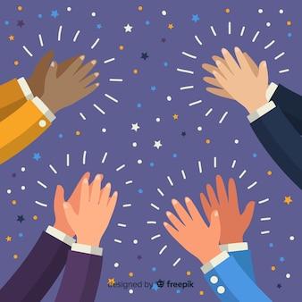 Mãos aplaudindo com fundo de confete