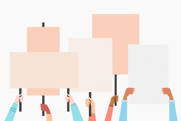 Mãos com cartazes ilustrados