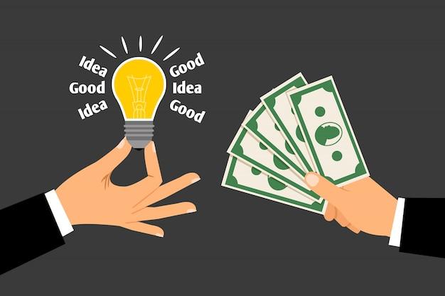Mãos com dinheiro e ideia