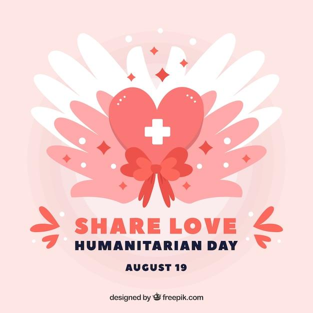 Mãos com fundo dos corações do dia humanitária