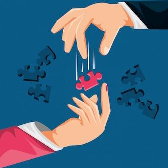 Mãos com peças de quebra-cabeça