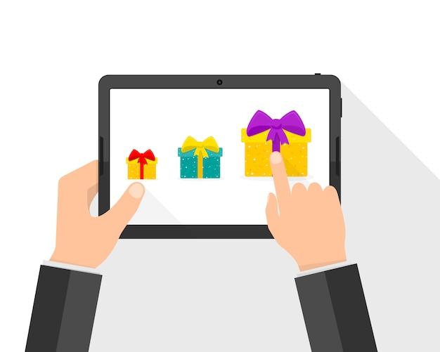 Mãos com tablet e caixas de presente. ilustração
