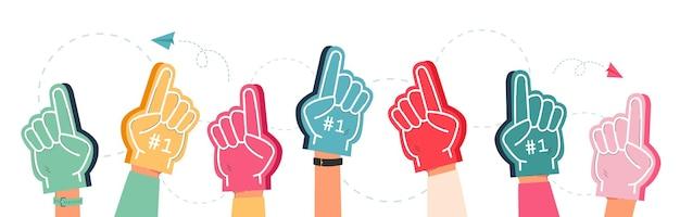 Mãos da equipe de apoio em dedos de espuma