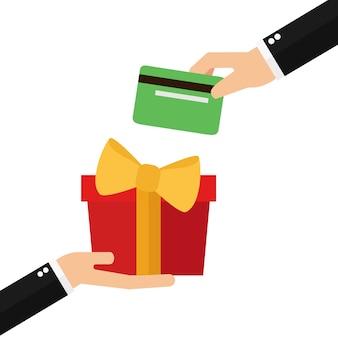 Mãos de empresário com presente embalado e cartão de crédito