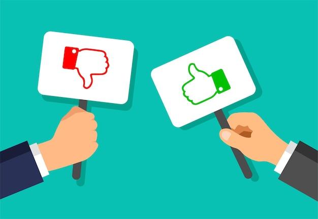 Mãos de empresário seguram placas com gestos de gosto e não gosto
