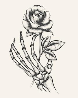 Mãos de esqueleto com flor rosa