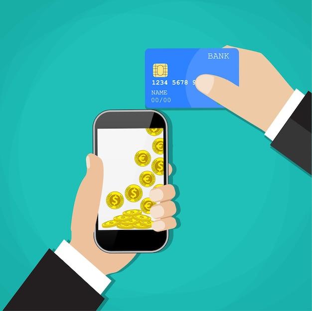 Mãos de homem segurando um telefone celular e um cartão de crédito.