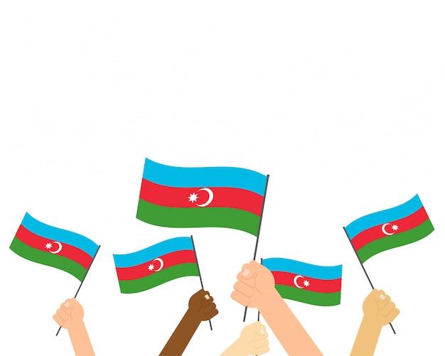 Mãos de ilustração vetorial segurando bandeiras do azerbaijão