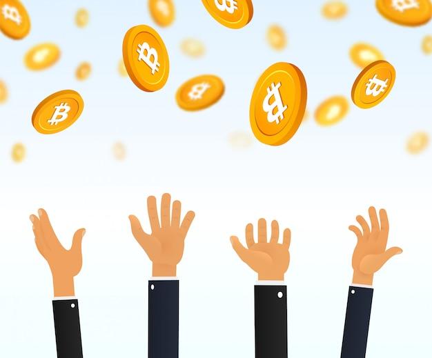 Mãos de pessoas pegando criptomoeda bitcoin caindo do céu.