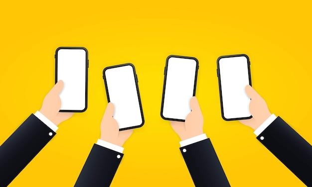 Mãos de smartphones em mãos. tela em branco.