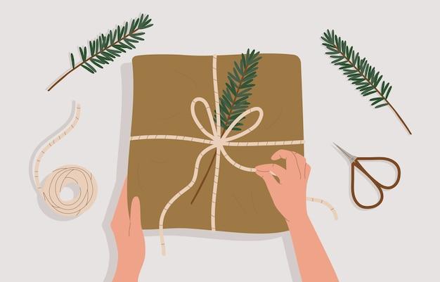 Mãos e caixa de presente na mesa