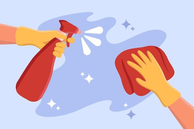Mãos em luvas de borracha limpando a superfície com spray e pano