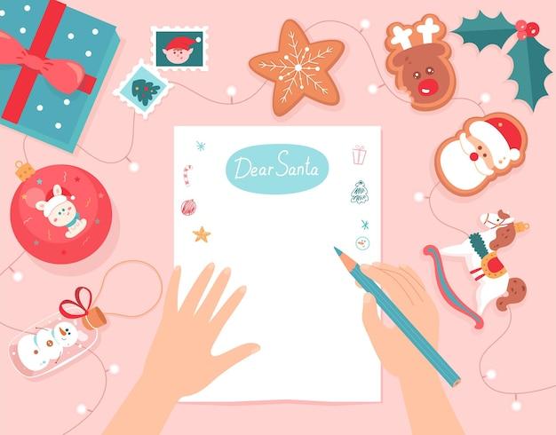 Mãos escrevendo uma carta de natal para a pessoa do papai noel segurando um lápis para escrever uma lista de desejos