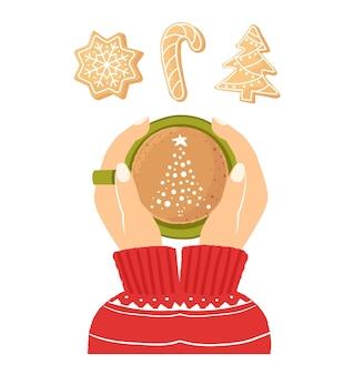Mãos femininas segurando uma xícara de café vista superior biscoitos de gengibre de natal