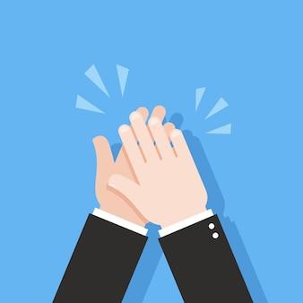 Mãos humanas batendo palmas.