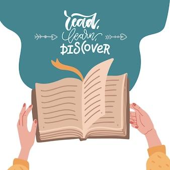Mãos humanas femininas segurando um livro com citação de letras - ler, aprender a descobrir.