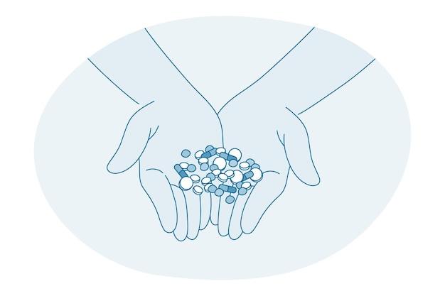 Mãos humanas segurando uma variedade de comprimidos de cápsulas de medicamentos farmacêuticos