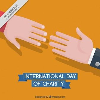 Mãos juntas no dia internacional de caridade