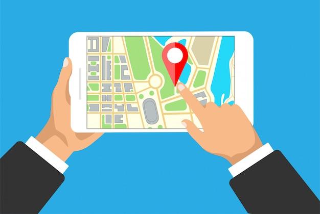 Mãos mantém tablet com mapa de navegação em uma tela. navegador gps com pinpoint vermelho. mapa da cidade com marcadores de ponto.