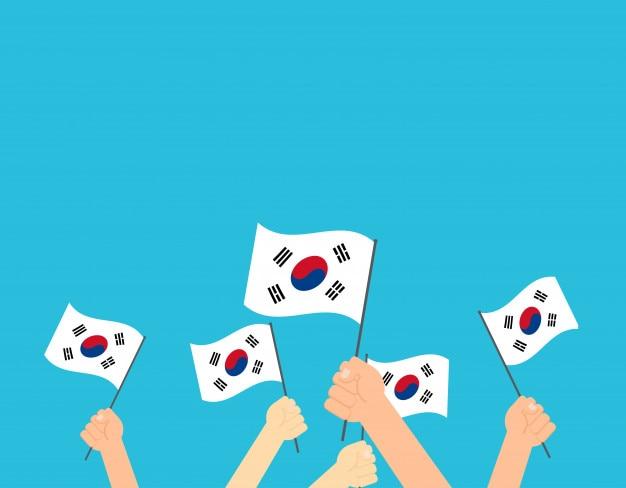 Mãos segurando a bandeira da coreia do sul
